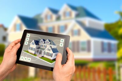 hands holding a tablet showing a real estate listing